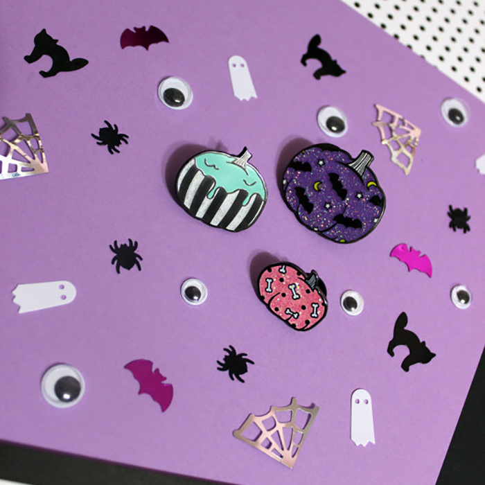 Need some new Halloween enamel pins for your collection? From ghosts and goth pumpkins to Oujia boards, here are 13 of my favorite picks.
